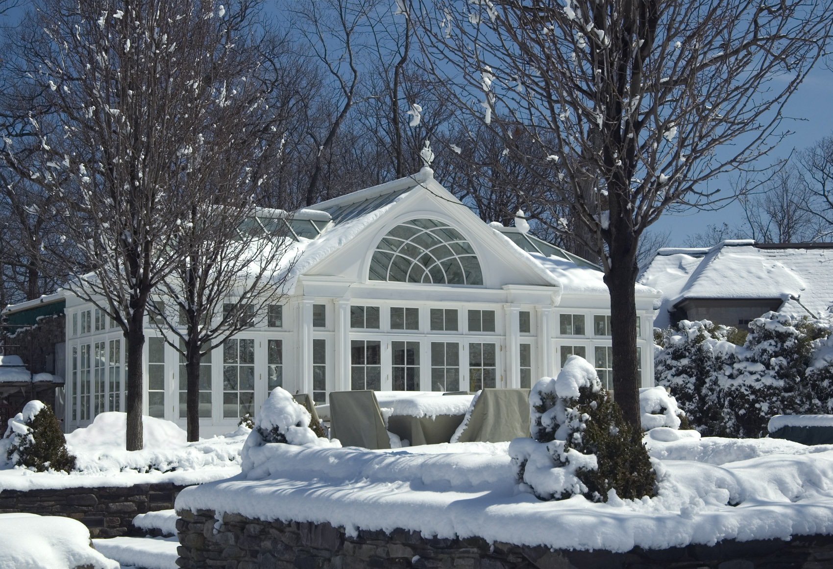snowy pool house conservatory